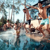 friends-enjoying-outdoor-pool-party-summer-vacation-concept
